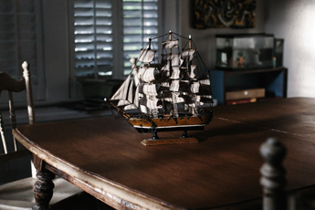 Model boat on table